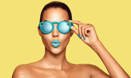 A woman wearing Google Gl– sorry, Snap Inc's Spectacles.