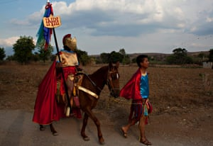 Men dressed as a Roman centurion and a soldier parade during the celebration of Holy Week in San Andrés Zautla, Mexico