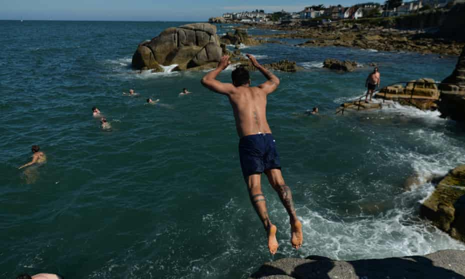 A swimmer jumps into the water at Forty Foot in Sandycove, Dublin.