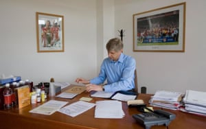 Arsène Wenger at his desk at Arsenal's training ground in 2007. The club without him will take some getting used to.