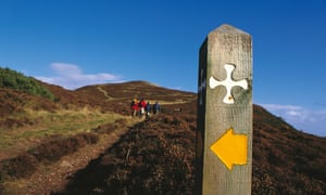 Saintly progress … walkers on St Cuthbert's Way at Eildon Hill, south of Melrose.