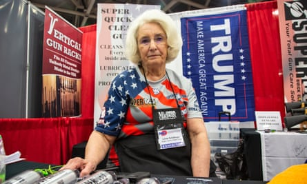 NRA member Linda Schillinger sits in her booth at the NRA convention in Dallas, Texas.