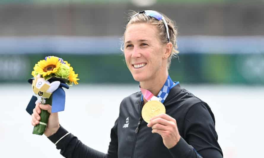 New Zealand's Emma Twigg with her gold medal after winning the single sculls in Tokyo.