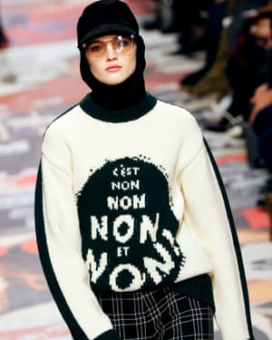 The season's opening look was a sweater with a feisty intarsia logo