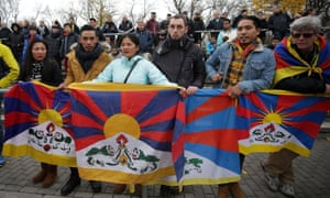 Spectators raise Tibetan flag to protest China's politics regarding Tibet at a football match between TSV Schott Mainz and China's U20 team.