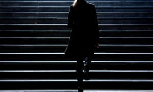 Silhouette of a woman walking up some stairs