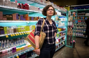 Emily Holden shops at the Whole Foods in their neighborhood in Washington, DC, February 23, 2019. Emily is the environment reporter for The Guardian US and has been wearing a silicone band developed by Oregon State University to measure chemicals from the surrounding environment over time. The wristbands can absorb volatile and semi-volatile compounds directly from the air and enable researchers to correlate location with air pollutants.
