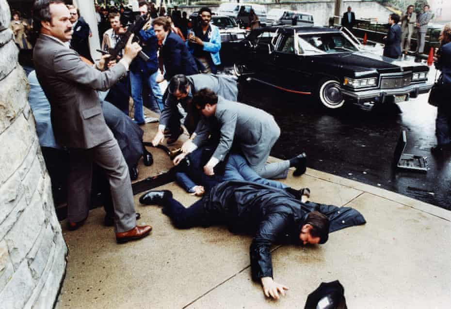 The moments just after John Hinckley tried to assassinate Ronald Reagan, on 30 March 1981 outside the Washington Hilton hotel.