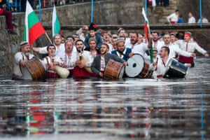 Kalofer, Bulgaria: men perform the traditional Horo dance in the Tundzha river, as part of Epiphany Day celebrations
