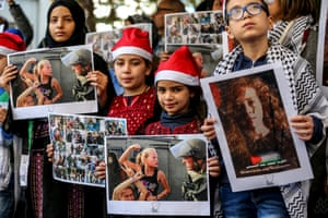 Protesters in Beirut carry pictures of Palestinian detainees as they call for the release of Ahed Al-Tamimi