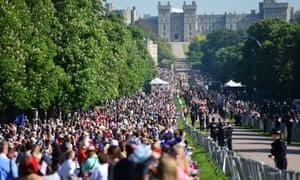 Royal fans line the Long Walk in Windsor towards the castle.