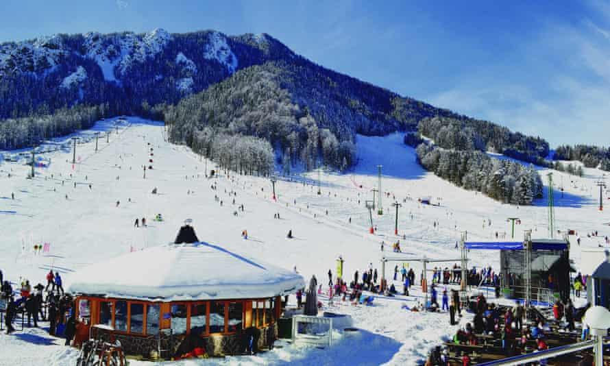 Ski resort and slopes filled with skiiers at Kranjska Gora, Slovenia.