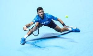 Novak Djokovic stretches for a forehand.