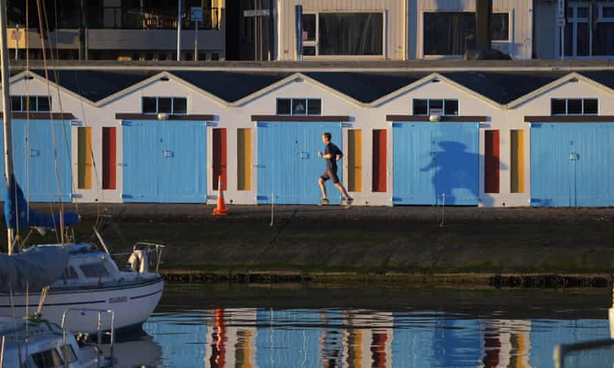 A runner runs past the boat sheds on Oriental Parade at 7.30am, Friday during Level 4 lockdown for the COVID-19 pandemic in Wellington COVID-19 pandemic lockdown, Wellington, New Zealand - 20 Aug 2021