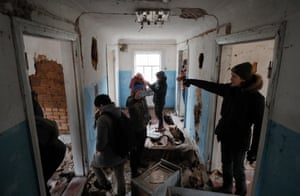 Tourists visit an abandoned building at the village of Zalissia in the Chernobyl exclusion zone