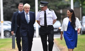 Boris Johnson and Priti Patel, the home secretary, arriving at West Midlands Police's learning and development centre