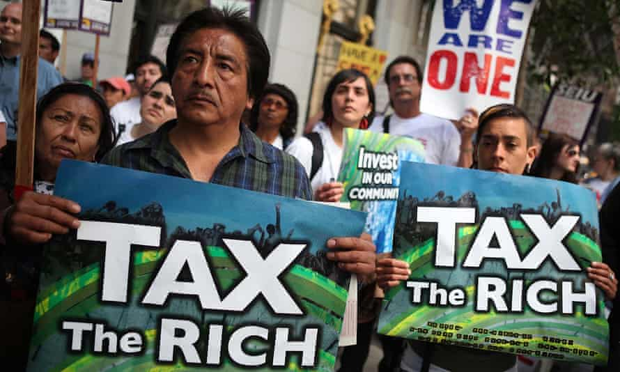 Protestors hold signs during a demonstration outside of the Wells Fargo shareholders meeting on May 3, 2011 in San Francisco, California. Over 100 housing activists staged a demonstration.