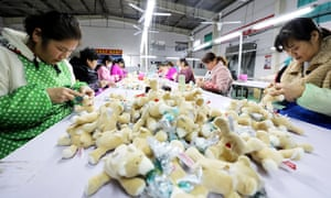Factory workers making stuffed animals at a toy company in Huaibei city, east China's Anhui province.