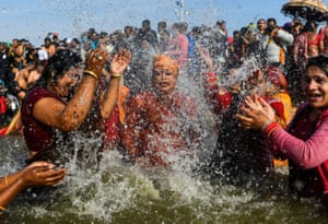 Followers of the transgender Kinnar Akhara monastic Hindu order take a dip for the first time at the Kumbh Mela.