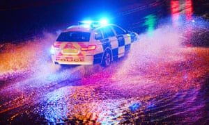 A Bedfordshire police BMW 4 x 4 on an emergency call charges through flash flooding in Church Street on July 18, 2017 in Dunstable, England
