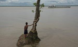 A child looking at a ship is pictured on June 11, 2016 in Ghoramara Island, India. Ghoramara Island is an island 92 km south of Kolkata, in the Sundarban Delta complex of the Bay of Bengal. The island is roughly five square kilometers in area, and is quickly disappearing due to erosion and rise in sea level.
