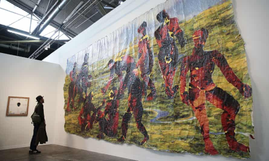 The Armory Show: a viewer checks out Kay Hassan's Untitled.