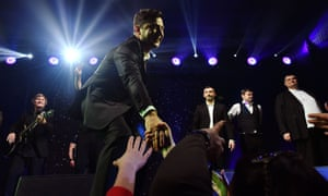 Volodymyr Zelensky shakes hands with supporters during a performance in Kiev.
