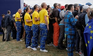 Europe fans try to get a better look amid big crowds at Le Golf National.