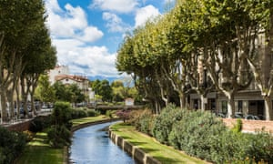 Perpignan's tree-lined Basse River on a sunny day