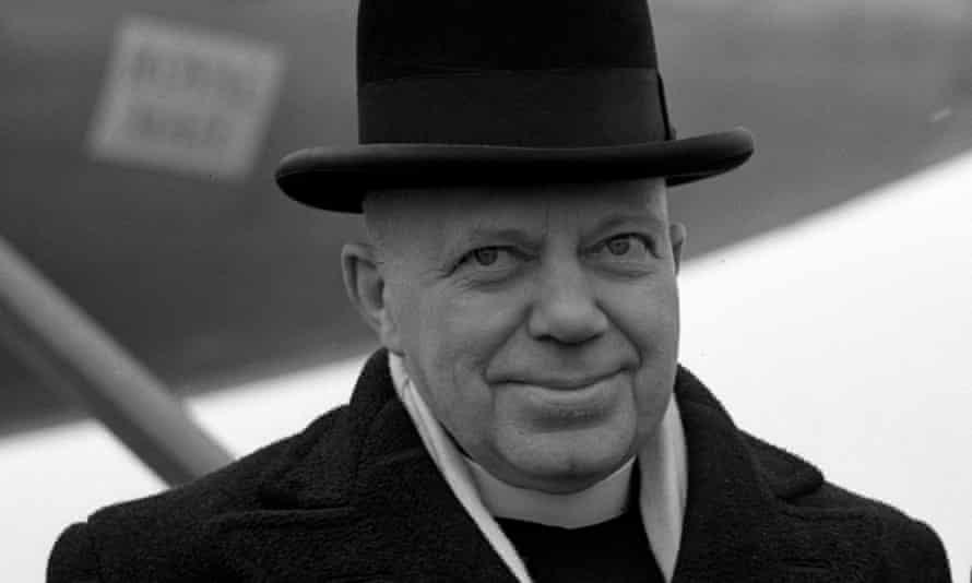 Bishop Bell smiling in a black hat