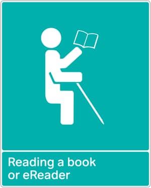 An RNIB graphic shows cane user reading