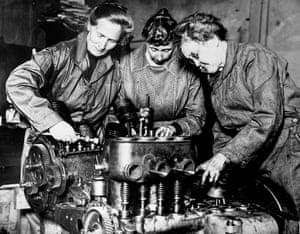 Auto mechanics repair an engine, Los Angeles, California, c1915–1920.