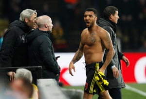 Troy Deeney walks.