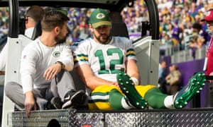 Aaron Rodgers is carted to the locker room after injuring his shoulder