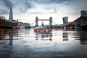 Extinction Rebellion float a replica of a British house on the River Thames, as part of a work titled Our House is Flooding and aiming to highlight the inaction on rising sea levels