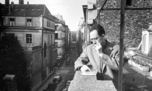 Waiting it out ... Albert Camus on the balcony at Gallimard, his publisher's office, in Paris in the 1950s.