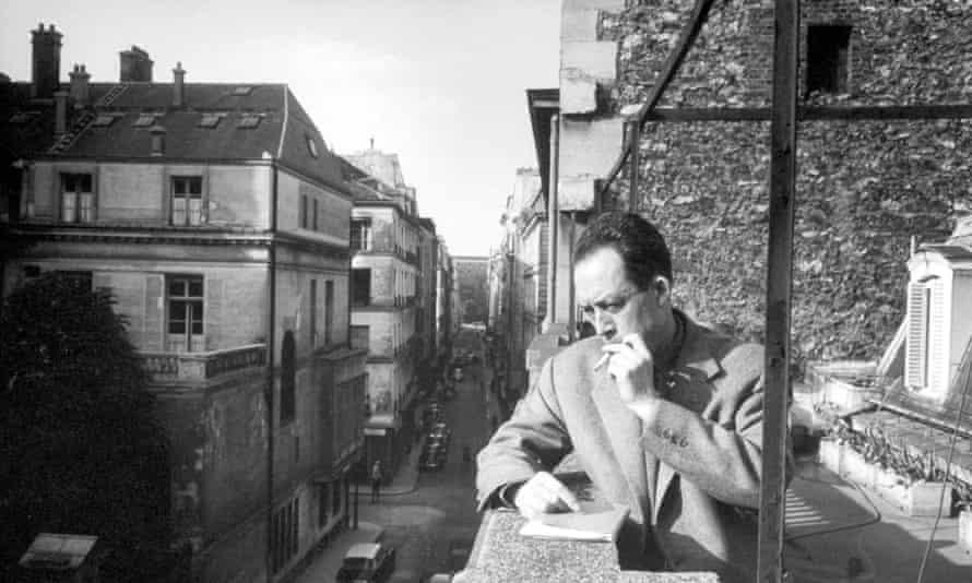 Albert Camus  smoking cigarette on a balcony