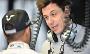 Toto Wolff (right) speaks with Mercedes driver Lewis Hamilton during practise at the Australian Grand Prix.