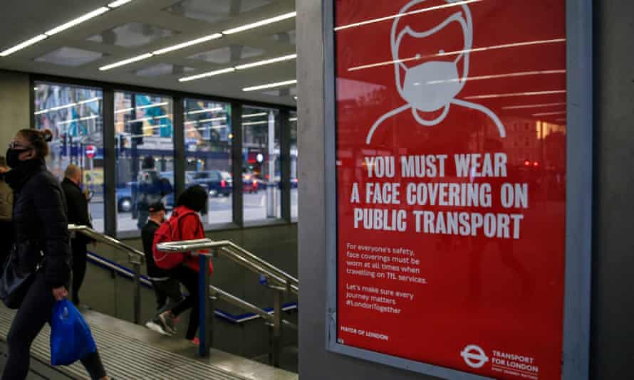 A notice about wearing face coverings at King's Cross St Pancras station