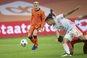 Netherlands' Donny van de Beek, left, scores his side's equaliser.