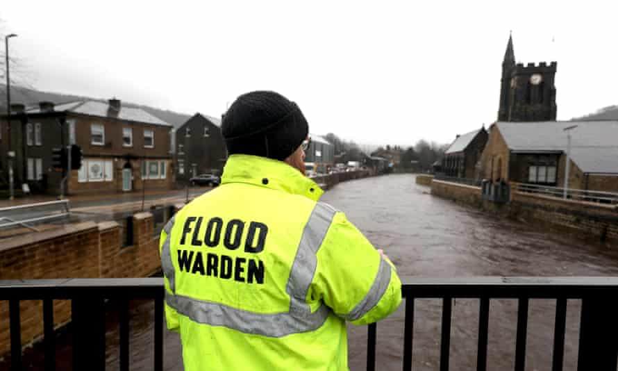 A flood warden looks at the water levels of the River Calder in Mytholmroyd, West Yorkshire. Storm Christoph brought widespread flooding to the UK in January.