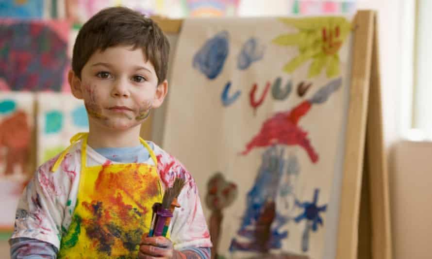 messy boy in art class