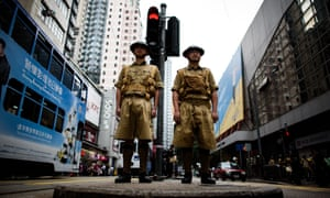 Members of a historical group pose in Hong Kong during an event marking 75 years since the British surrendered to the Japanese in WW2.