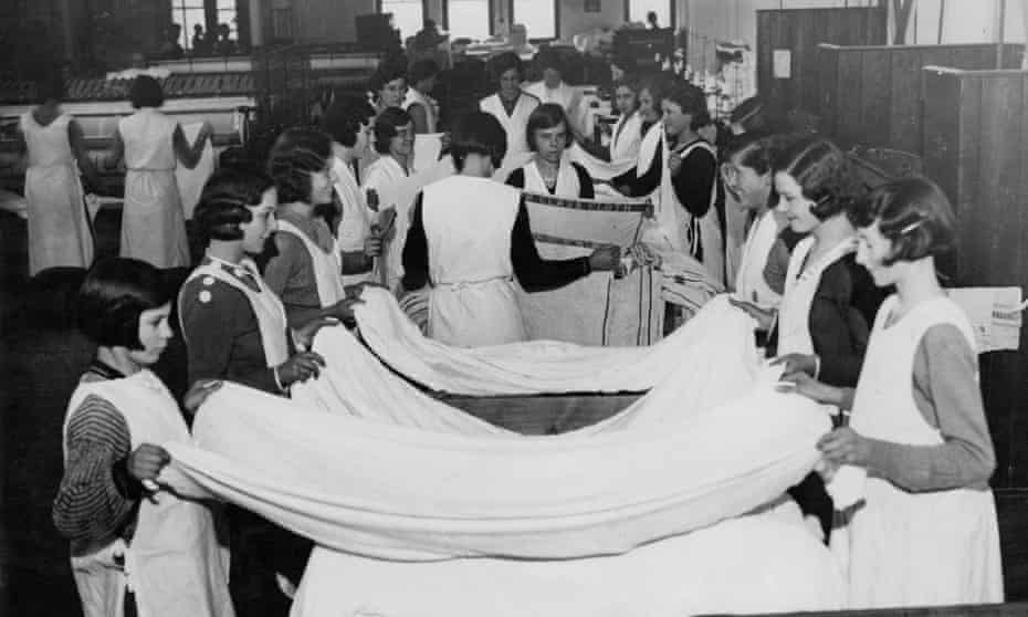 Young women at work in a commercial laundry, c1930.