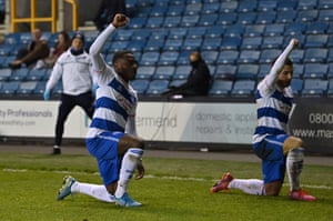 QPR's Ilias Chair celebrates with Bright Osayi-Samuel by taking the knee.
