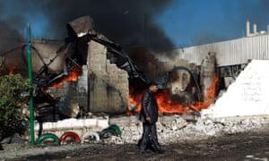 Aftermath of Saudi-led coalition airstrike as buidling burns