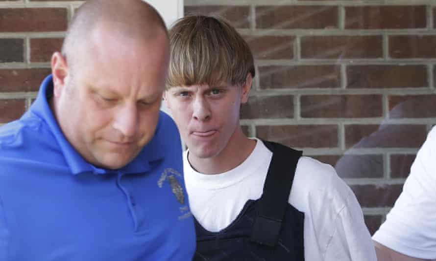 Charleston shooting suspect Dylann Storm Roof (centre) is escorted by police.