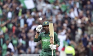 Pakistan's batsman Haris Sohail raises his bat after reaching his half century.