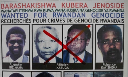A wanted poster in Kigali with Félicien Kabuga's face crossed out.