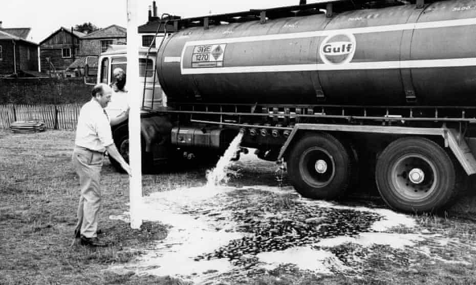 Jim Riches, secretary Of Richmond Rugby Club supervises unloading of water onto the club's pitch.